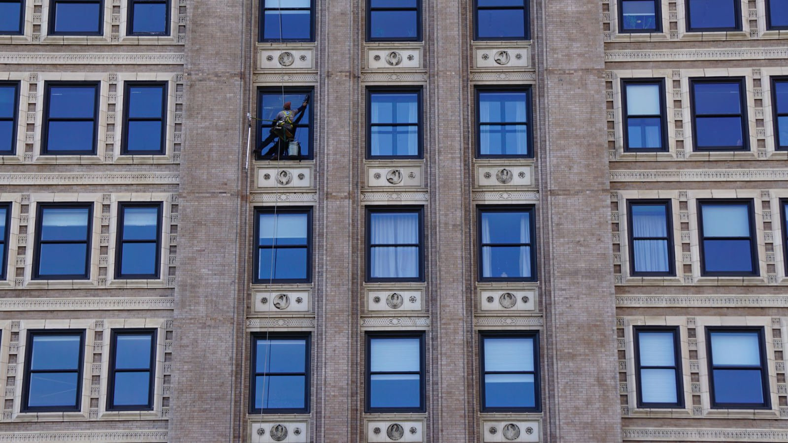 A window cleaner doing work that looks unreachable